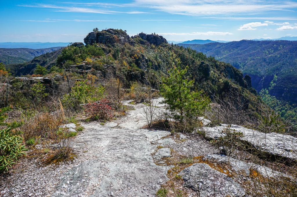 View of the Chimneys from the Mountains to Sea Trail just south of the Table Rock Picnic Area. This view adds an extra 2 miles to the hike