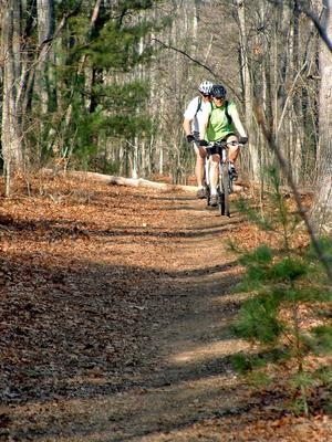 Riders on Hardtimes Connector trail.