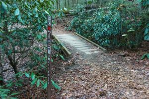 Small Creek Trail Sign and Bridge