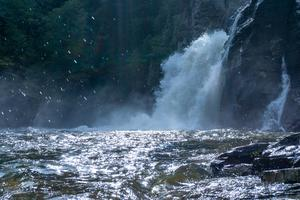 The power of Linville Falls turns the plunge basin into a churni