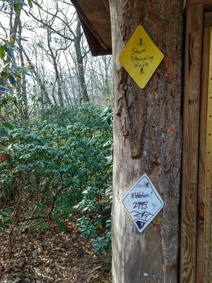 Blaze and Elevation Placards at the Start of Stomping Knob Trail