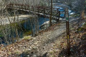 Sign and Bridge on River Loop Trail